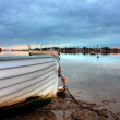 Boat at low tide — Stock Photo