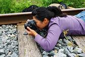 Girl photographer — Stockfoto