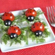 Ladybug tomato and olive with cheese - Stock Photo