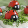 Royalty-Free Stock Photo: Ladybug tomato and olive with cheese