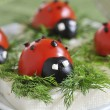 Ladybug tomato and olive with cheese — Stock Photo #2738553