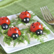 Ladybug tomato and olive with cheese — Stock Photo