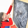 Little girl and blackboard - Foto Stock