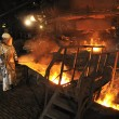 Stock Photo: Molten hot steel pouring and worker