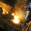 Molten hot steel pouring — Stock fotografie