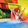 Stock Photo: Children sliding down water slide