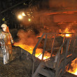 Molten hot steel pouring and worker — Stock Photo