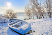 Blue boat on danube river — Stock Photo