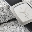 The arm watch with the leather strap on stone — 图库照片 #3649775