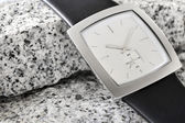 The arm watch with the leather strap on stone — ストック写真