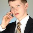 Businessman with mobile phone portrait — Stock Photo
