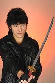 Young asian man holding samurai sword — Stock Photo
