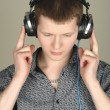 Royalty-Free Stock Photo: Man listening a music in headphones