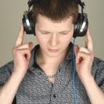 Man listening a music in headphones — Stock Photo