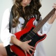 Woman in men shirt with red guitar — Stock Photo