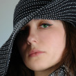 Closeup portrait woman in black hat - Stock Photo