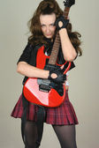 Young woman with red guitar — Stock Photo