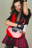 Woman stay with red electro guitar — Stockfoto