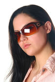 Young woman wearing sunglasses on isolat — Stock Photo
