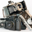 Stock Photo: OLD CAMERAS PYRAMID ON WHITE