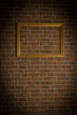 Brick old wall with gold framewor — Stock Photo