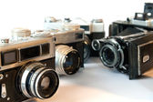 Old photo cameras isolated on a white — Stock Photo
