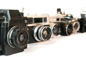 Old photo cameras on a white — Stock Photo