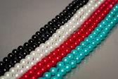 Ligne de perles de couleur quatre — Photo