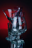 Group alcohol glass on a red bg — Stock Photo