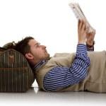 Boy is reading magazine on the floor — Stock Photo