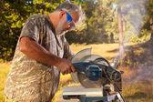 Senior Man Operating a Chop Saw — Stock Photo
