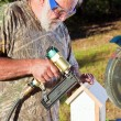 Senior Man Building a Bird House — Stock Photo