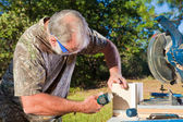 Man Uses a Nail Gun — Stock Photo