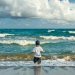 Boy walking in the sea — Stock Photo #3432977