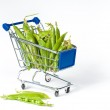 Metal shopping trolley filled with green pies — Stock Photo #3436599