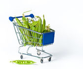 Metal shopping trolley filled with green pies — Stock Photo