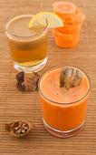 Fresh carrot juice and fruit — Stock Photo