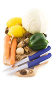 Mixed vegetables on a wooden board — Stock Photo