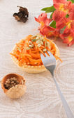 Carrot salad in a basket — Stock Photo