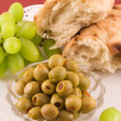 Royalty-Free Stock Photo: Fresh bread with grapes and olive