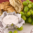 Fresh bread with grapes and cheese — Stock Photo