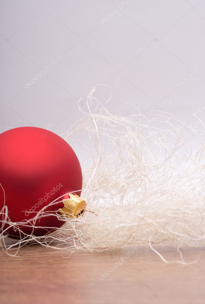 Red bauble on a wooden floor. — Stock Photo #3665470