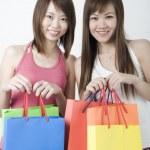 Asian girls shopping — Stock Photo