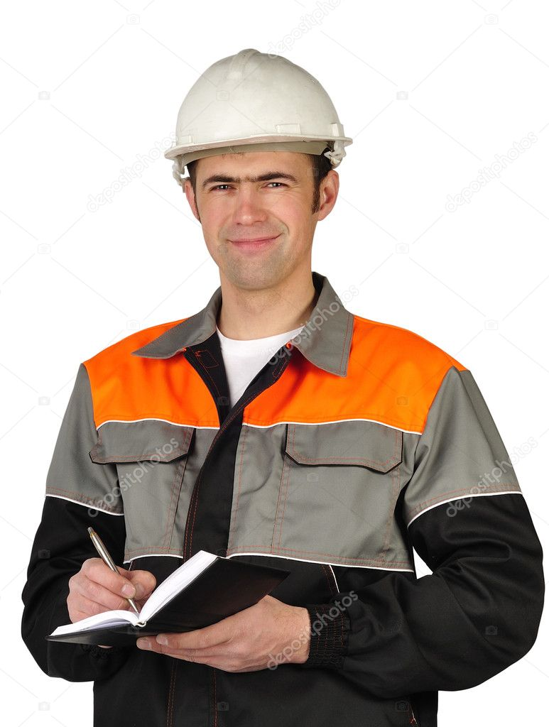 The chief engineer in a helmet writes in a notebook on a white background — Stock Photo #3290269