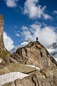 Small figure on the peak — Stock Photo