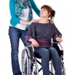 Stock Photo: Two girls one on wheelchair