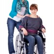 Two girls one on wheelchair — Foto de Stock