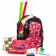 Black and red packback with school supplies - Stok fotoğraf
