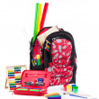 Black and red packback with school supplies - Stock Photo