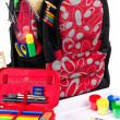 Black and red packback with school supplies — Stock Photo #3744362